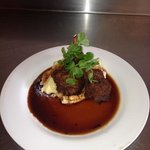 mint and rosemary crumbed cutlets with red wine jus