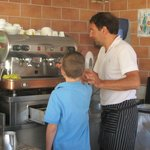 Breakfast Chef shows our grandson how to make cappuccino.