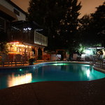 The Pool And Bar Area At Night