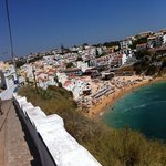 The hotel Carvoeiro Sol is the blue building in the middele of image
