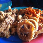 Seafood platter with onion rings and sweet potato fries
