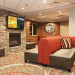 Lobby area equipped with two LCD televisions and fireplace