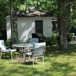 Each cottage has a outdoor grill and patio table