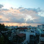 sunset over the roofs of Saigon from the terrace