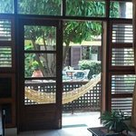 View out to porch hammock and pool courtyard.