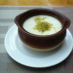 Almond pudding with pistachio topping