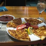 Lamacun, a traditional Turkish flatbread, had a delicate, crispy crust topped with lamb, vegetab