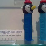Display of some Penguin PEZ Dispensers