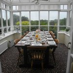 Breakfast conservatory with view over river valley