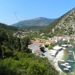 Hotel Nostos taken from high above Frikes Harbour showing set in valley location but near shops
