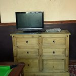 tv and dresser in games room