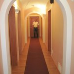 The view down the hallway with rooms on either side