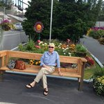 Bench in front of hotel with pretty flower garden