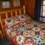 Log headboards and Quilts in every cabin