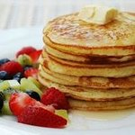 Homemade Pancakes with Fruit and Maple Syrup