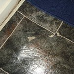 Tiles peeling off the bathroom floor plus mould