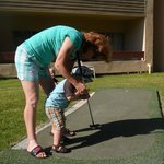 my almost 2 year old playing mini golf
