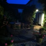 tranquil Mediterranean style courtyard at night, a lovely place to relax