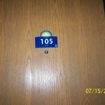 picture of the door of the room described