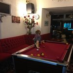 My son Robert enjoying a game of pool in the hotel lounge.