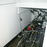 bicycles in unused space under entry stairs