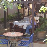 My wife awaiting breakfast at Hotel Las Volcanes