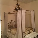 The Gabriel room complete with antique metal bed and private bath and lots of natural light.