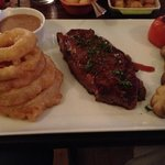 Sirlion steak, peppercorn sauce with stack of onion rings