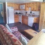 View of the full kitchen from the dining/murphy bed area