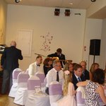 The function suite where marriage ceremony took place with stage in the background where band pl