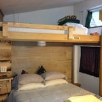 queen size bed and bunks