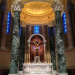 Inside in front of the alter