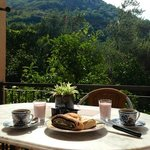 Breakfast on the terrace with mountain and garden view