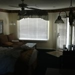 dated fixtures and drapes, couches with stains