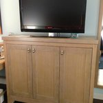 TV and beautiful cabinet/dresser.
