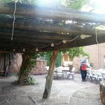 Pergola on back patio (Santa/Brett setting tables)