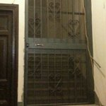 the locked gate inside the door from the street