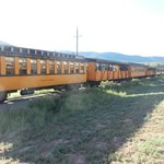 Historic train cars passing hotel