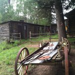 An old log structure and wagon, everywhere you turn - it's scenic!