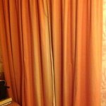 Bedroom and faded curtains