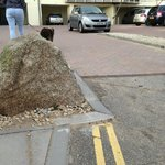 rock poking out into the road