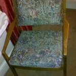 Naff chair, dingy carpet.