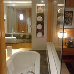 Bathroom with motorized screen