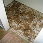 Shower floor in cottage was natural rock - hard on sensitive feet - no mat provided