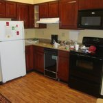kitchenette with full size refrigerator, stove, microvave and even a dishwasher!