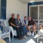 The owners, Linda and David, with me and my husband on the porch