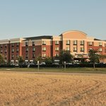 SpringHill Suites-Las Colinas: sunset view across open grassy lots.