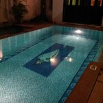 Pool at night. The folding doors to the kitchen. Great area to serve food for a poolside party.