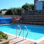 outdoor pool (sun loungers out of shot on left)