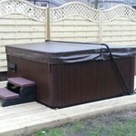 Hot tub in back garden all year round.